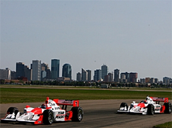 Helio Castroneves leads team mate Ryan Briscoe during the IRL IndyCar Rexall Edmonton Indy.  (Darrell Ingham/Getty Images)