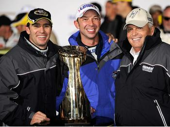 (L-R) Jimmie Johnson celebrates with his crew chief Chad Knaus and team owner Rick Hendrick after winning the NASCAR Sprint Cup Series NASCAR Banking 500 at Lowe's Motor Speedway on October 17, 2009. (Rusty Jarrett/Getty Images for NASCAR)