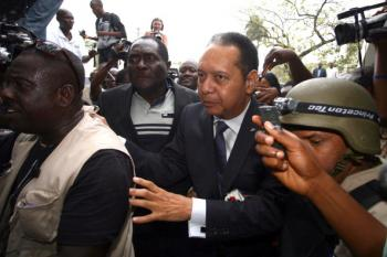Former Haitian dictator Jean-Claude 'Baby Doc' Duvalier(C) arrives at the prosecutors office in Port-au-Prince Januay 18, 2011.  (Hector Retamal/AFP/Getty Images)