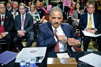 Attorney General Eric Holder arrives for a hearing before the Senate Judiciary Committee on Capitol Hill Nov. 18 in Washington, DC. The hearing was to examine the 'Oversight of the Department of Justice.'  (Alex Wong/Getty Images)