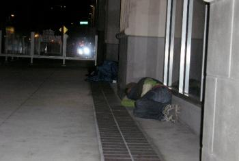 Two homeless men are sleeping on the street in downtown San Diego Nov. 12.   (Gisela Sommer/The Epoch Times)