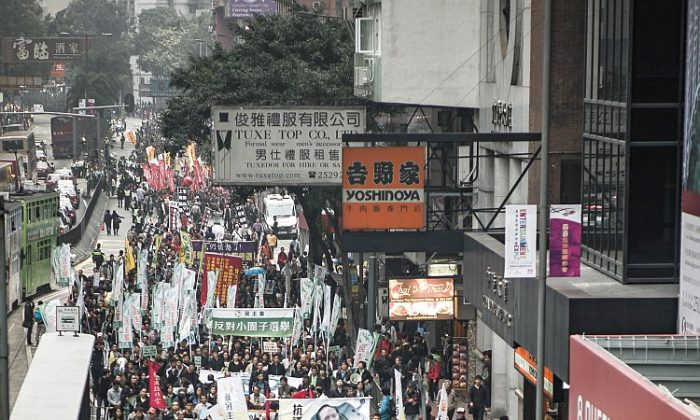 Protesters march to voice their dissatisfaction with the territory's leader, Chief Executive Donald Tsang, in Hong Kong on March 3, 2012. They also called for direct elections in the southern Chinese territory ahead of elections on March 25. Tsang, whose term is up in June, agreed on March 1 to cooperate with an investigation into his alleged ties to rich tycoons, after revelations of his jaunts on private jets and yachts, and denied he had breached bribery laws. (Philippe Lopez/AFP/Getty Images)