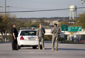 Members of the military and police stand outside Fort Hood on November 5, 2009 in Killeen, Texas.  (Ben Sklar/Getty Images)