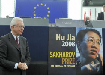 European Parliament President Hans-Gert Pottering poses next to the empty seat of Chinese dissident Hu Jia on December 17, 2008 during the awards ceremony of the 2008 Sakharov Prize. (Dominique Faget/AFP/Getty Images)