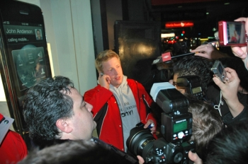 New Zealander Jonny Gladwell is the first person to buy an Apple iPhone 3G after a bet from his friends that he wouldn't last the time in the queue. (Salina Wang/The Epoch Times)