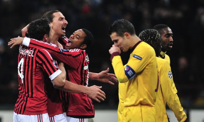 AC Milan's Zlatan Ibrahimovic celebrates his goal in a Champions League hammering of Arsenal on Wednesday in Italy. (Giuseppe Cacace/AFP/Getty Images)