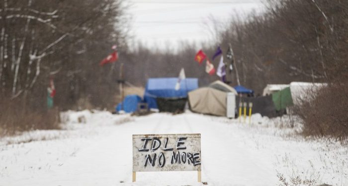 First Nations protesters continue to blockade the CN tracks in Sarnia, Ont., on Wednesday, January 2, 2013, after a court injunction to have them move was issued over the holidays. The protest, part of the Idle No More movement, has blocked the tracks for 13 days. (The Canadian Press/ Geoff Robins)