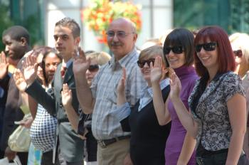 Around a hundred new Canadians gathered in Toronto for a swearing in ceremony on World Refugee Day last June.  (Matthew Little/The Epoch Times)