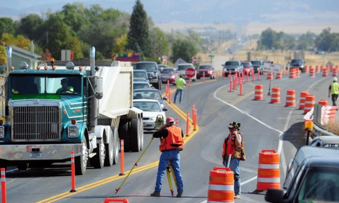 Construction workers working on a new interchange on I-15 in Helena, Montana, on September 30, 2011 (Eliza Wiley/ Independent Record)