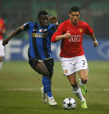 ONE TO WATCH: Manchester United's Cristiano Ronaldo (right) is closely monitored by Inter Milan's Sulley Muntari. Ronaldo had several chances to win the match for United. (Alex Livesey/Getty Images)