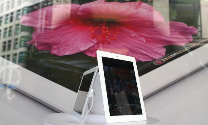 An iPad is seen in a window display at an Apple Store on April 24, in San Francisco, Calif. Apple set a record, becoming the most valuable company in history by market capitalization. (Justin Sullivan/Getty Images)