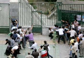 Members of the Iranian hardline volunteer Basij militia enter Tehran's university where supporters of the Islamic republic's defeated presidential candidate Mir Hossein Mousavi were protesting against the latest election's results at Tehran's University on June 14, 2009. (AFP/Getty Images)