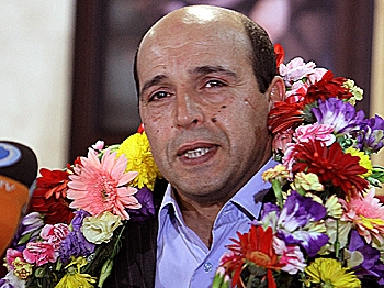 Iranian agent Ali Vakili Rad arrives at Imam Khomeini Airport as he addresses journalists in Tehran, on May 18, 2010, after his release from a French prison. (Atta Kenare/AFP/Getty Images)