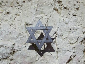 Iron Star of David set into a rock in a Jerusalem park (Zeev Barkan)