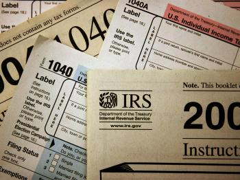 In a nutshell, the proposed tax preparers' requirements include registration, competency tests, continued professional training, and complying with a set of ethical standards. (Scott Olson/Getty Images)