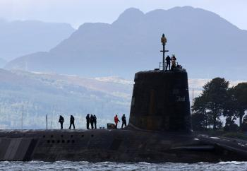 A Trident submarine makes it's way out from Faslane Naval base on September 23, 2009, in Faslane, Scotland. The new British prime minister will need to consider cutting the Trident missile-carrying submarines. (Jeff J Mitchell/Getty Images )