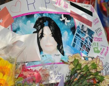 Posters, signs, candles and flowers are left by fans at a makeshift shrine outside the Jackson family compound in Encino, California on June 28, 2009. The FBI released their Michael Jackson files to the public. (Robyn Beck/AFP/Getty Images)