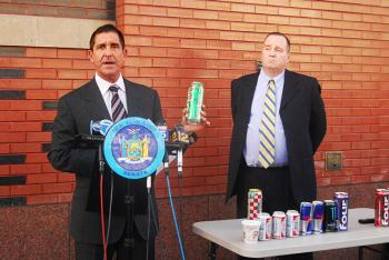 CAFFEINATED BEER: Mike Jones, deputy CEO of State Liquor Authority (R) and state Senator Jeff Klein (L), holding a can of Four Loko, announced a ban on caffeinated alcoholic beverages. (Catherine Yang/The Epoch Times)