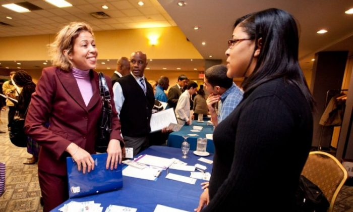 Job seekers at a career fair on April 18 in Manhattan. (Amal Chen/The Epoch Times)
