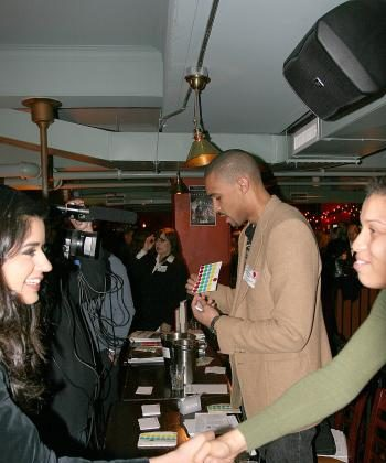 SHAKE ON IT: Job seekers and recruiters meet and mingle at the Galway Hooker on East 36th St. (Tim McDevitt/The Epoch Times)