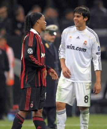 Ronaldinho (left) and Kaka chat after their Champions League encounter at the San Siro on Tuesday. (Christophe Simon/AFP/Getty Images)