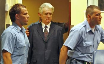 Former Bosnian Serb leader Radovan Karadzic (C) enters the courtroom of the International Criminal Tribunal for the Former Yugoslavia at his initial appearance on July 31, 2008, in The Hague. (Jerry Lampen/AFP/Getty Images )