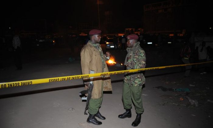 Kenyan policemen secure the blast area after explosionsat a bus station in downtown Nairobikilled at least threepeopleon March 10. (Simon Maina/AFP/Getty Images)