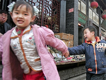 Children hold hands while walking along a street in the ancient city of Pingyao, in northern China's Shanxi province. China's skewed sex ratio has been one consequence of its one-child policy, as many couples, particularly in rural areas, prefer a boy and (Frederic J. Brown/AFP/Getty Images)