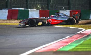 Heikki Kovalainen spins at Degner corner during qualifying for the Japanese Formula One Grand Prix. (Vladimir Rys/Bongarts/Getty Images)