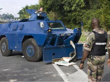 French gendarme watches as barricades set up by activists of the Collective against Exploitation (LKP) are removed, on February 16, 2009 in Gosier, Caribbean islands of Guadeloupe.  (Julien Tack/AFP/Getty Images)