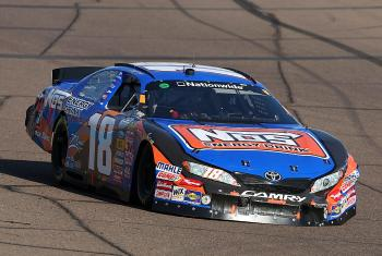 Kyle Busch pushed his #18 NOS Toyota up to ninth, despite serious damage to the left front and right rear. He didn't clinch the title at Phoenix, but he almost certainly will at Homestead. (Christian Petersen/Getty Images)
