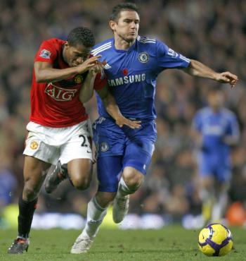 THE BATTLE: Chelsea midfielder Frank Lampard (right) vies with Manchester United's Antonio Valencia (L) at Stamford Bridge in London on Sunday. (Ian Kington/AFP/Getty Images)
