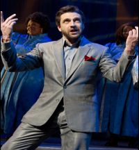 Raúl Esparza as Jonas Nightingale surrounded by the Angels of Mercy choir. (Joan Marcus)