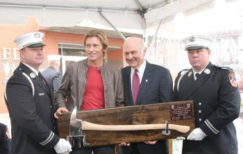 Actor and president of the Leary Firefighters Foundation, Denis Leary (2nd from left) is presented with a mounted fireman's axe by NYC Fire Commissioner Nicholas Scoppetta (2nd from right) and FDNY Captains Michael Maye (left) and Marc Merra during the de (Getty Images)
