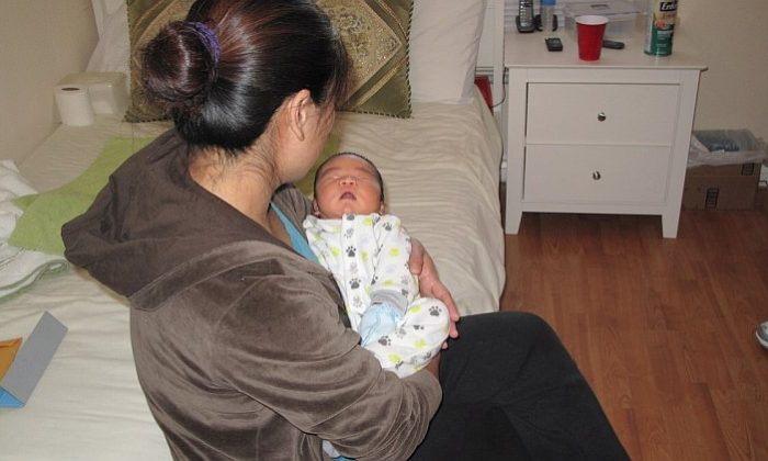 Mrs. Liu fled from China to escape a forced abortion. She gave birth to her baby in Los Angeles on Dec. 2, 2011. (Jenny Liu/The Epoch Times)