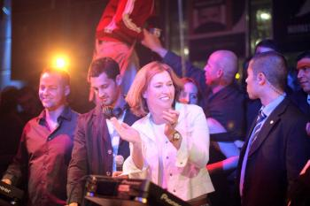 Israeli Foreign Minister and Kadima party candidate Tzipi Livni (2R) dances in the DJ booth during an election campaign party at the Ha'oman 17 dance club Feb. 3, 2009 in Tel Aviv, Israel.  (Uriel Sinai/Getty Images)