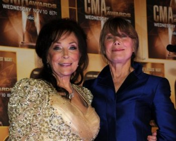 Loretta Lynn and Sissy Spacek pose in the press room at the 44th Annual CMA Awards at the Bridgestone Arena  in Nashville, Tennessee on Nov. 10, 2010. (Larry Busacca/Getty Images)