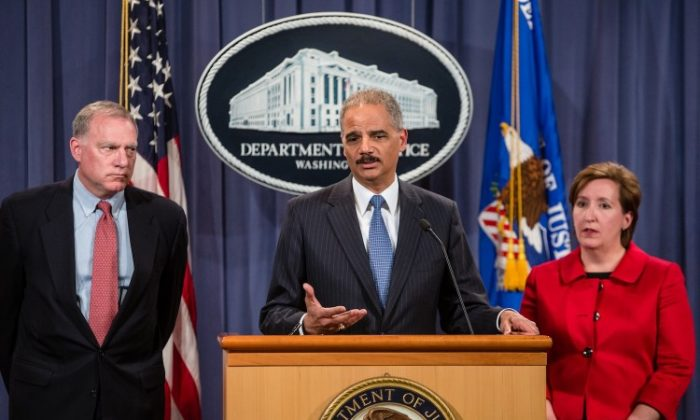 Connecticut Attorney General George Jepsen, U.S. Attorney General Eric Holder, and Acting Assistant Attorney General of the Anti-trust Division Sharis A Pozen announce an anti-trust lawsuit filed against Apple at the U.S. Department of Justice on April 11 in Washington, D.C. A class action suit was filed by a Canadian lawyer in the BC Supreme Court last week. Apple is accused of setting the price of e-books artificially high. (Brendan Hoffman/Getty Images)