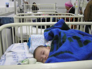 Baby Mahmud, from Gaza, receives treatment in Barzilai hospital. (The Epoch Times)