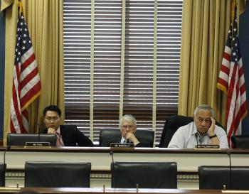ADVOCATES: Congressman Don Manzullo (center) with Congressman Eni Faleomavaega (right), and one of Mr. Manzullo's aides, at a congressional hearing on March 31. Reps. Manzullo and Faleomavaega drafted a letter seeking redress for the treatment Fellowes received in China. (Matthew Robertson/The Epoch Times)
