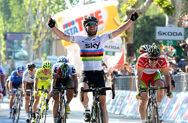 Sky's Mark Cavendish, in his rainbow-banded World Champion's jersey, beats Matt Goss in his red points leader jersey in Stage Five of the Giro d'Italia. (teamsky.com)