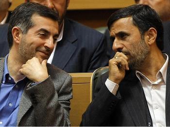 Iranian President Mahmoud Ahmadinejad (R) talks with aide Esfandiar Rahim Mashaie (L) at an  Iranian expatriates summit in Tehran, April 14, 2009. (Behrouz Mehri/AFP/Getty Images)