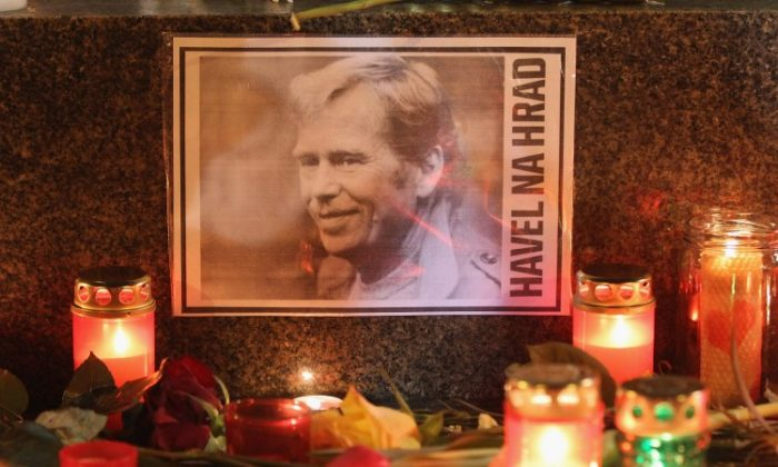 "A portrait of former Czech President Vaclav Havel, with a text that reads: ""Havel To The Castle,'""a popular slogan during the Velvet Revolution of 1989, is left by mourners to commemorate Havel's death on Dec. 18, in Prague, Czech Republic. (Sean Gallup/Getty Images)"