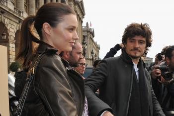 Miranda Kerr and Orlando Bloom depart from the Balenciaga Ready to Wear Spring/Summer 2011 show during Paris Fashion Week on Sept. 30, 2010 in Paris, France. (Pascal Le Segretain/Getty Images)