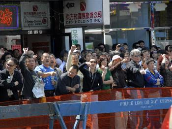 An angry mob heckles organizers at the 'Quit CCP' booth in Flushing, New York. (Dai Bing/Epoch Times)