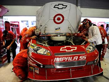 Crew members work on the wrecked #42 Target Chevrolet of Juan Pablo Montoya, in the garage after an incident with Tony Stewart's #14 Office Depot/Old Spice Chevrolet. (Rusty Jarrett/Getty Images for NASCAR)