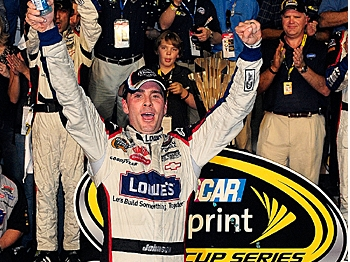 Jimmie Johnson celebrates after winning his fourth consecutive NASCAR Sprint Cup Series Championship with a fifth place finish in the Ford 400 at Homestead-Miami Speedway on November 22, 2009. (Sam Greenwood/Getty Images)
