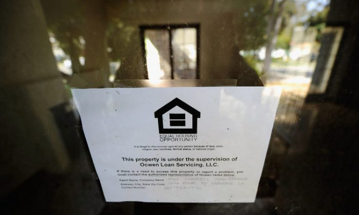 A loan servicing sign is posted on a foreclosed house in Glendale, Calif. (Kevork Djansezian/Getty Images)