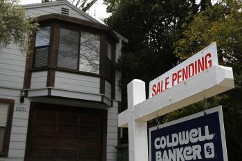 Mortgage rates were relatively unchanged this week, according to a Thursday report from Freddie Mac. (Justin Sullivan/Getty Images)