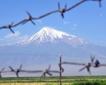 Mount Ararat is seen through a barbed-wire fence from the Armenian town Artashat on July 11, 2009. Archeologists from Noah's Ark Ministries say a boat they have found on Mount Ararat has a '99 percent' chance of being Noah's Ark of biblical fame. (Karen Minasyan/AFP/Getty Images)